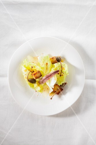 Caesar salad with polenta croutons, capers, anchovies and coriander
