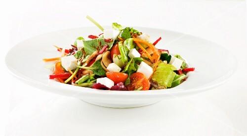 Tomato salad with carrots and mozzarella
