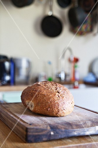 A loaf of country bread in a kitchen