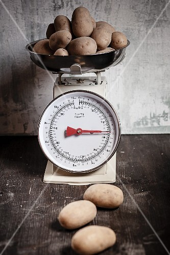 Potatoes on a pair of old kitchen scales
