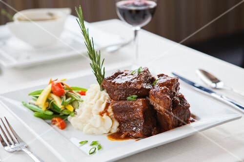 Braised beef with a side of vegetables