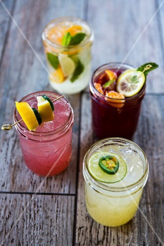 Four different refreshing glasses of lemonade