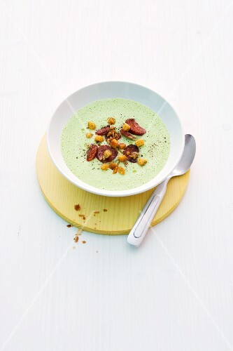 Pea soup with chorizo and croutons
