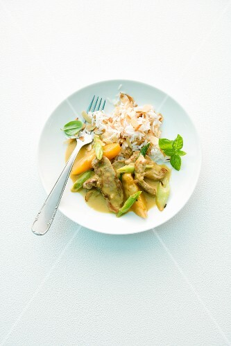 Pork with peaches, curry sauce and rice