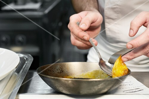 A chef working in a commercial kitchen