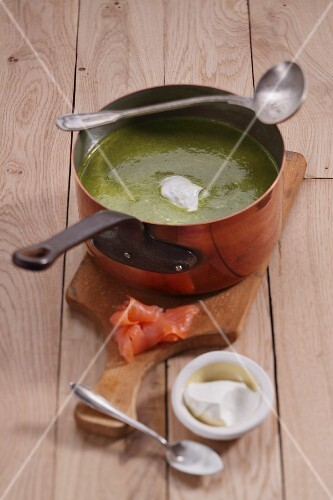 Spinach curry soup with smoked salmon and creme fraiche