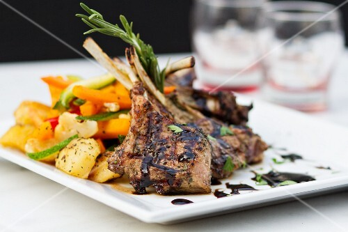 Grilled lamb chops with a side of vegetables