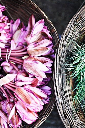 Lotus flowers and lemongrass in baskets at a flower market in Mumbai, India
