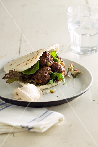 Pita bread filled with pistachio and apricot meatballs