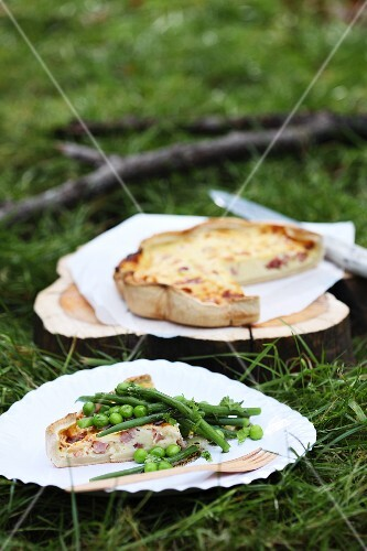 Quiche served with peas and green beans