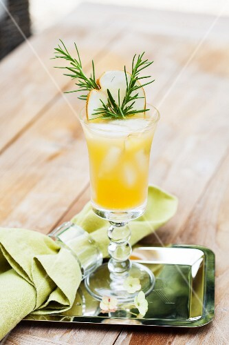 A fruity cocktail with rosemary
