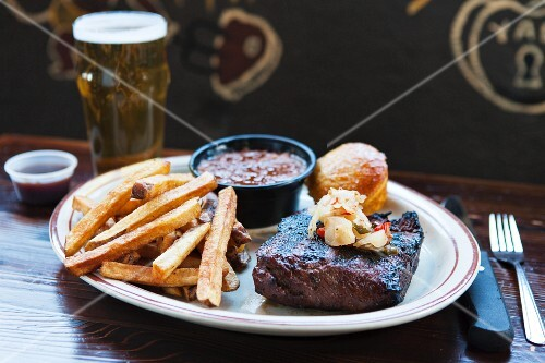 Beef steak with chips in a pub