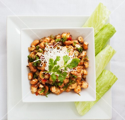 Beans with chilli peppers, grated cheese and coriander
