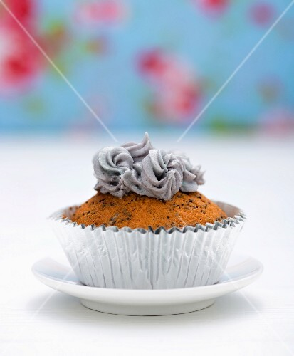 A cupcake topped with grey buttercream