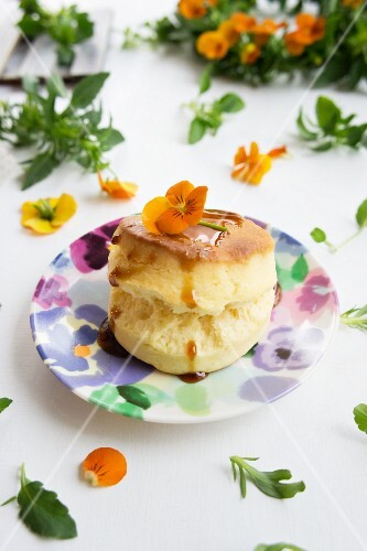 A scone with sugar syrup and tufted pansies