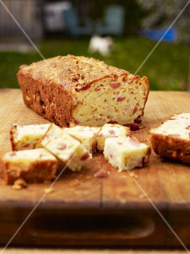 Cake with Gruyere and ham on a garden table