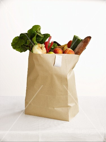 Fresh fruit and vegetables in a paper bag