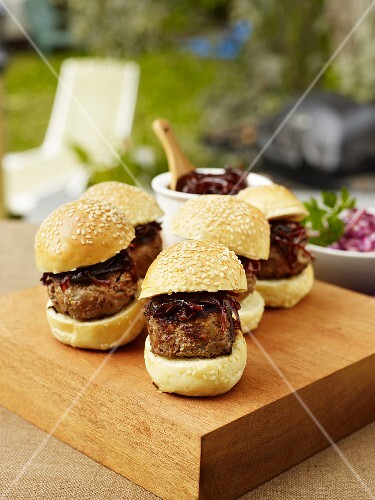 Mini burgers with onions on a garden table