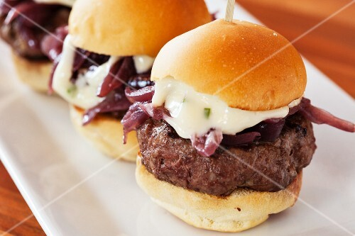 Mini cheese burgers with red onions