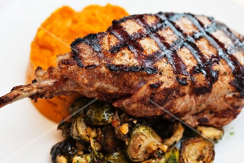 A grilled steak with a side of vegetables
