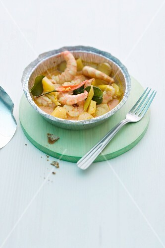 Prawn curry with pineapple in an aluminium dish