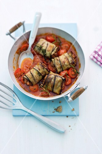 Aubergine parcels on a bed of tomatoes