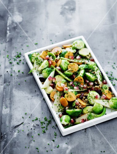 Brussels sprout salad with pomegranate seeds and walnuts