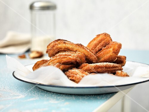 Churros dusted with icing sugar