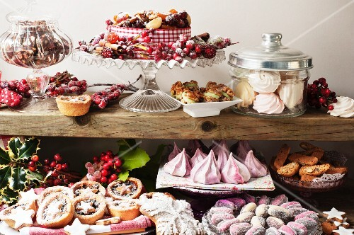 A Christmas buffet featuring meringues, stuffed dates, mince pies, Christmas cake and biscuits