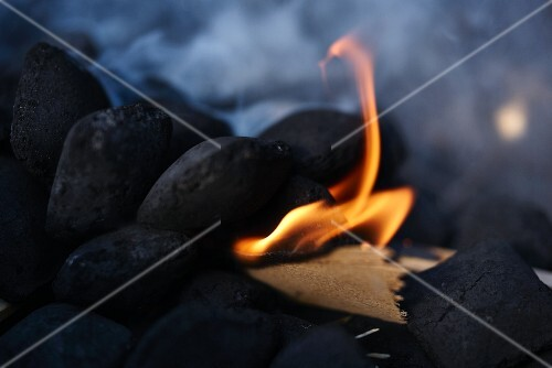 Barbecue coal being lit
