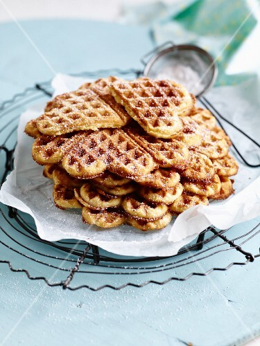 Heart-shaped waffles with icing sugar