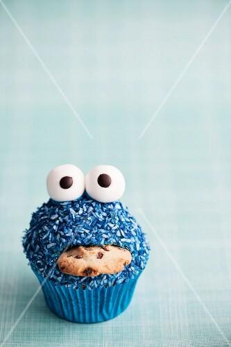 A blue monster cupcake