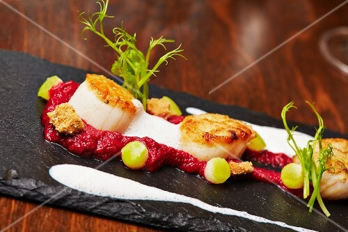Scallops on beetroot cream with apple pearls and nut crumble