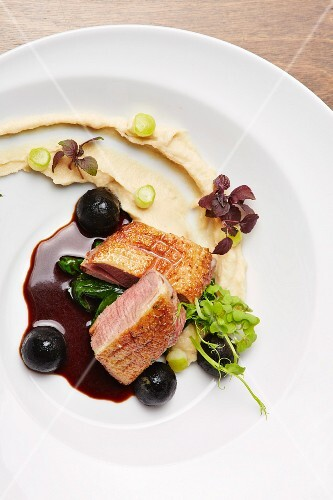 Duck breast on apple and celery cream with sepia potato pearls