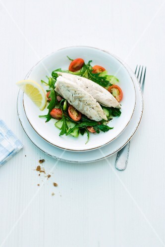 Seabass fillet on a rocket and tomato salad