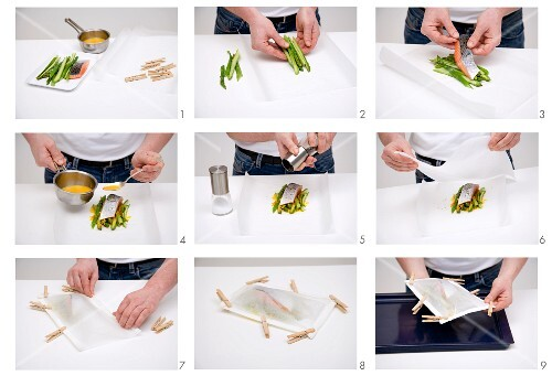 Salmon steak on green asparagus being wrapped in paper