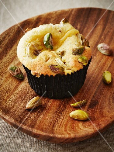 A cupcake with bananas and pistachios