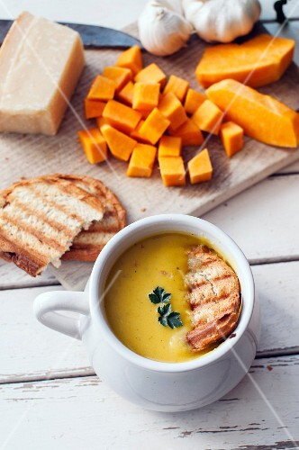 Butternut squash soup with grilled bread and ingredients