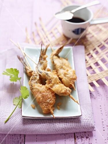 Herring in tempura batter on skewers