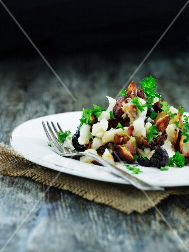 Cauliflower salad with bacon and prunes