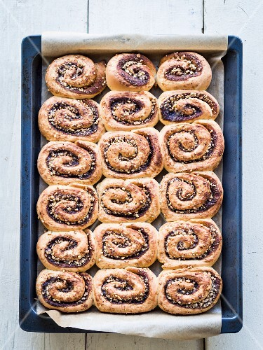 Freshly baked cinnamon rolls on a baking tray