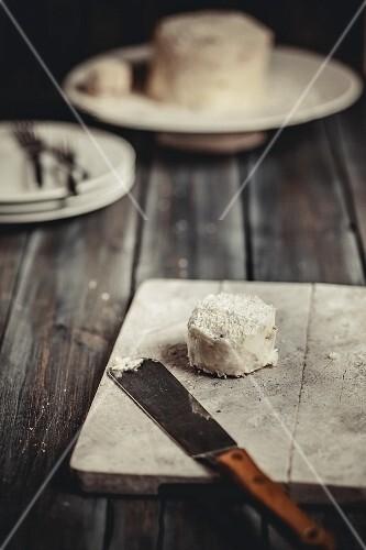 A mini coconut cake on a wooden board