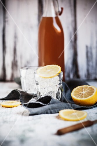 Japanese tea made from roasted barley (mugicha) with lemon slices and glasses of ice