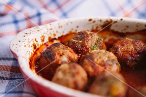 Minced meat and cabbage dumplings in tomato sauce