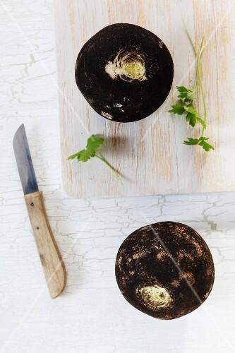 Fresh black radishes on a chopping board
