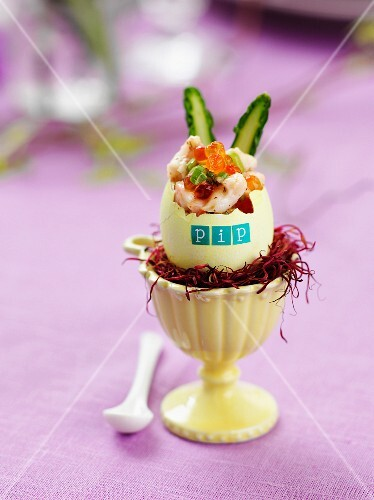 Prawn cocktail served in a labelled egg shell in an egg cup