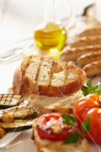 Grilled bread, grilled sausage and olive oil