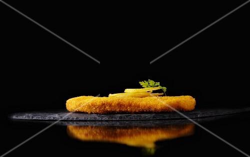 Breaded escalope on a slate platter