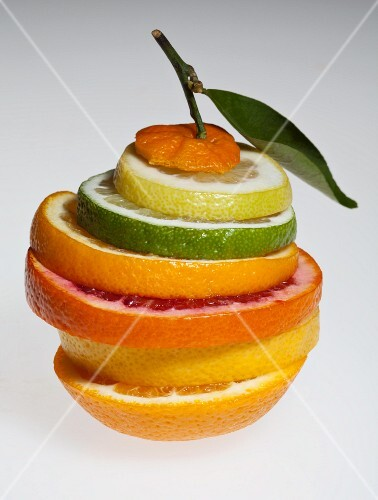 Various slices of citrus fruits (lemon, lime, orange, pink grapefruit, grapefruit)
