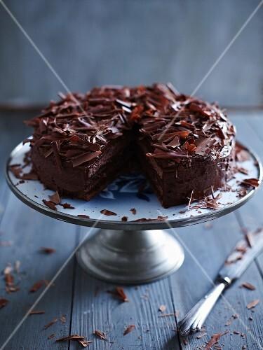 Dark chocolate cream cake with grated chocolate